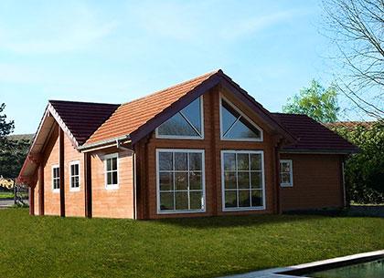 Chalet et maison bois en kit GreenLife : bois massif et ossature bois